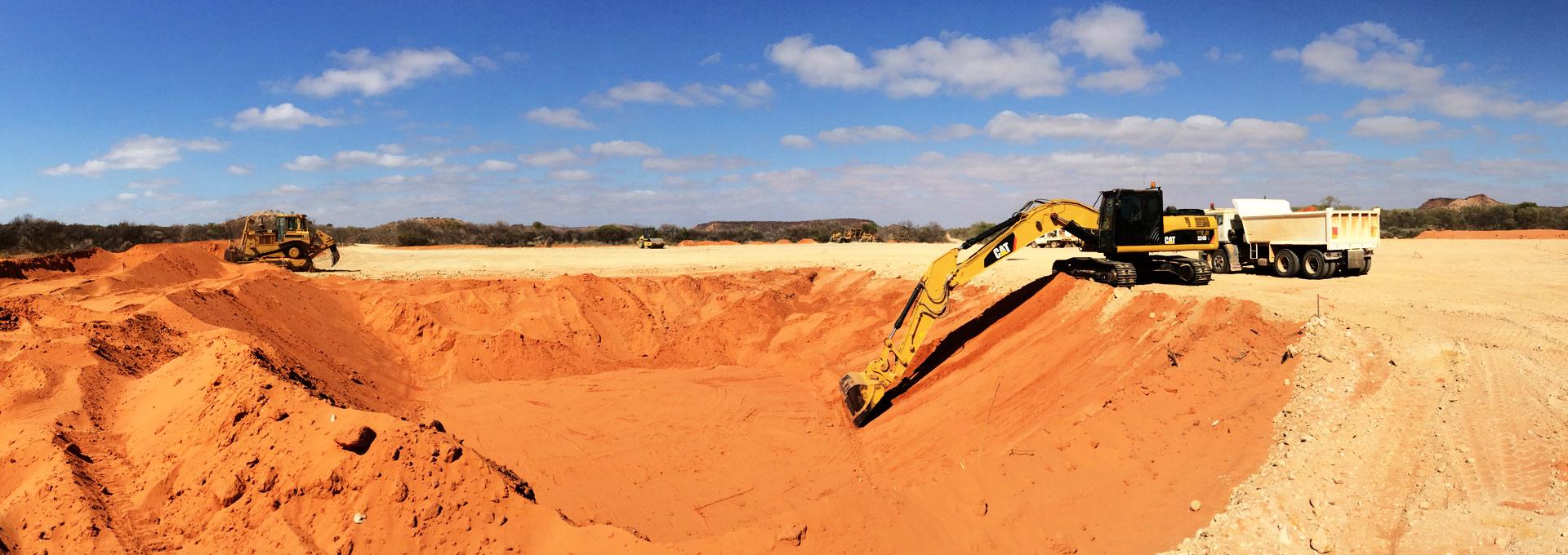 Earthmoving equipment and trucks doing civil works in Geraldton WA